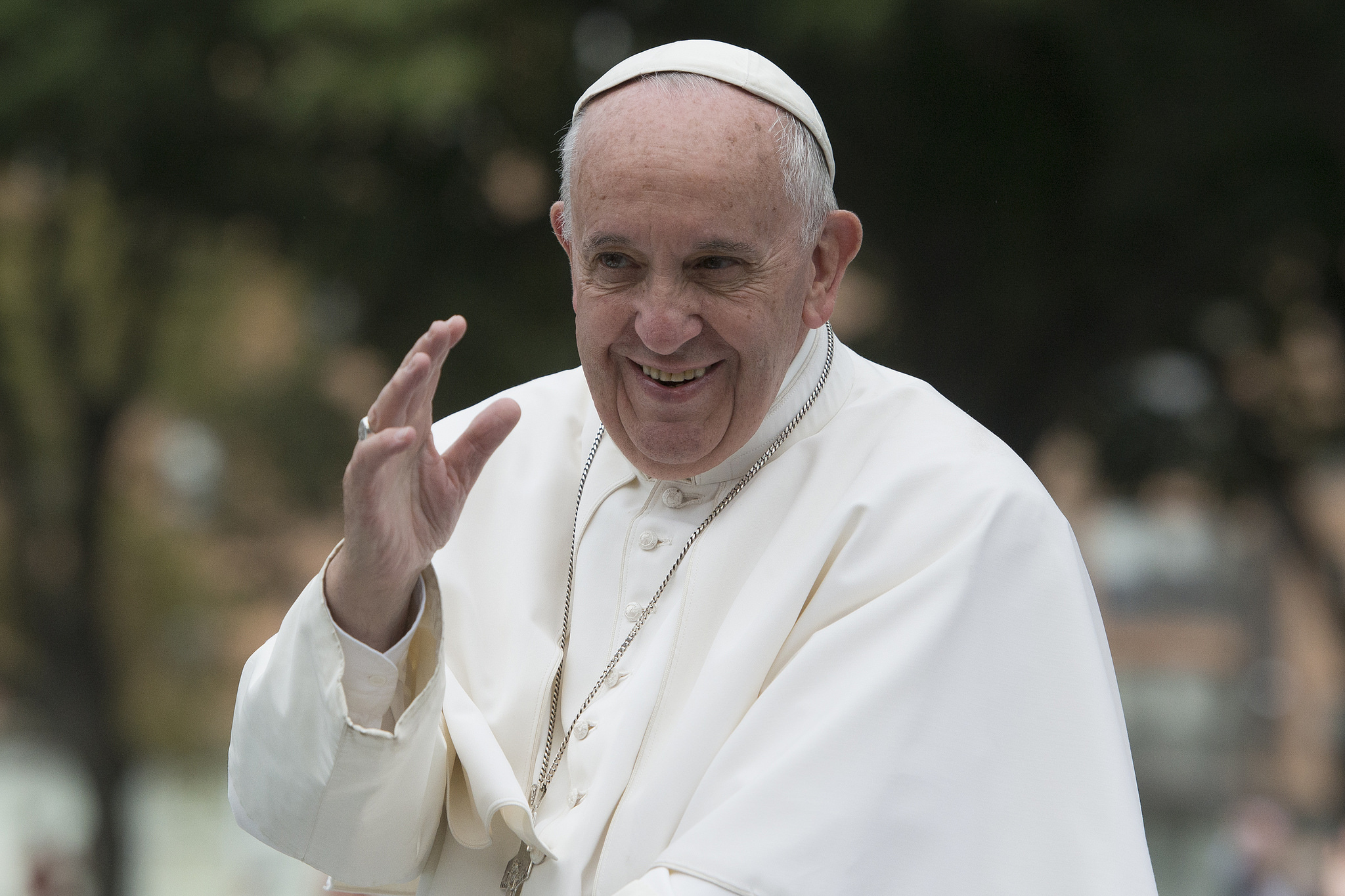 Pope Francis waves to crowds in Philadelphia during his September 2015 visit. Credit: Jeffrey Bruno.