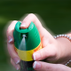 Woman applying mosquito repellent spray. Credit: CDC.