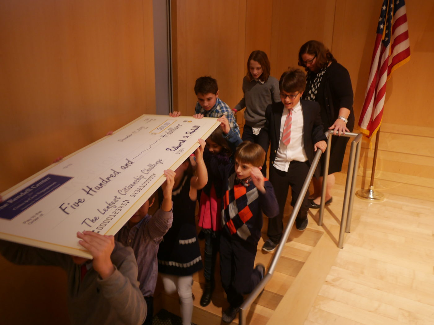 Merion Elementary students carry their winning check.