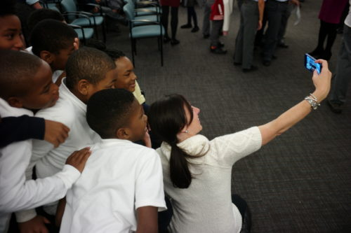 Melissa Murray Bailey takes a selfie with students.