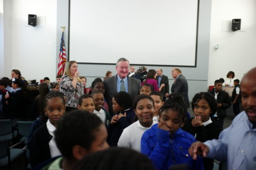 Jim Kenney poses for a photo with students.