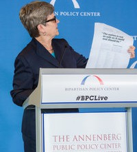 APPC director Kathleen Hall Jamieson with the Wall Street Journal ad. Credit: Greg Gibson Photography.