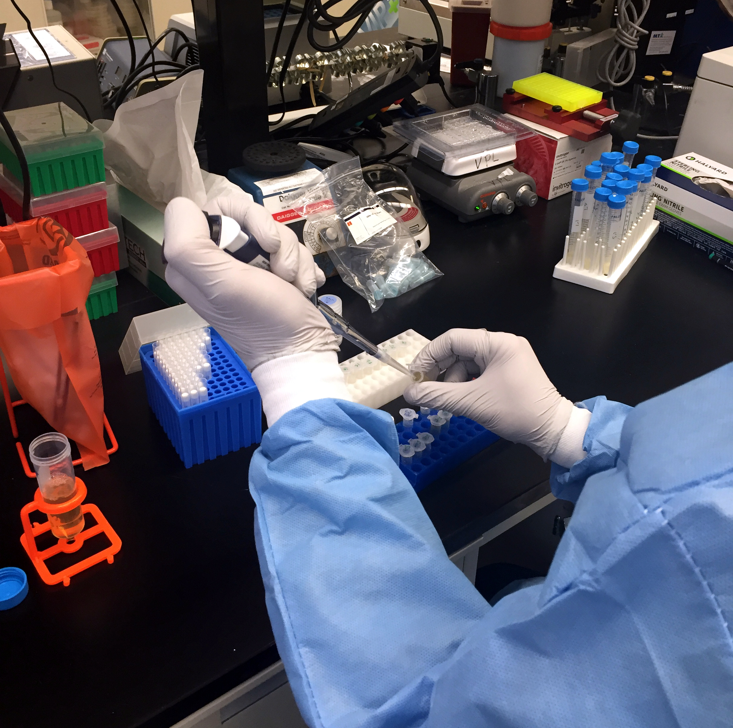 A Zika virus researcher at the NIAID Vaccine Research Center pipets samples. Credit: NIAID.