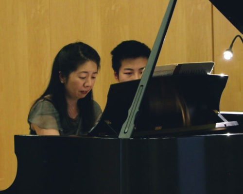 Pianist Reiko Uchida, with Penn student Sibo Wang assisting as page-turner.