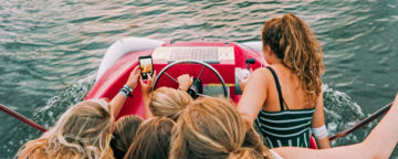 Adolescent risk-taking? Teens driving a boat and taking a selfie. Credit: Daan Stevens/Unsplash.