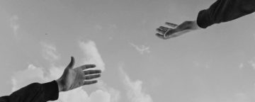 Hands reaching out to each other. Credit: youssef naddam/Unsplash.