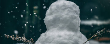 Lone snowperson at night. Credit: Matt Seymour/Unsplash.