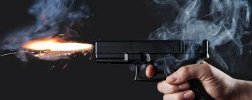 Gun firing.