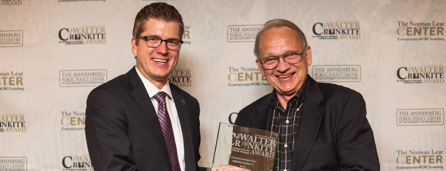 KUSA's Brandon Rittiman is presented with the 2015 Cronkite/Jackson Prize by FactCheck.org's founding director, Brooks Jackson.