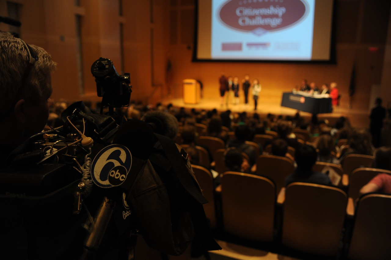 Camera crew from 6 ABC News films one of the presentations.